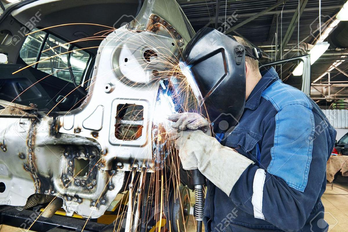 18628046-repairman-welding-metal-body-car-stock-photo-car-repair-manufacturing